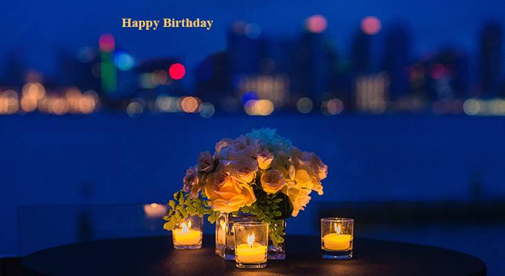 happy birthday wishes, birthday cards, birthday card pictures, famous birthdays, city lights, candles, white roses, romantic dinner