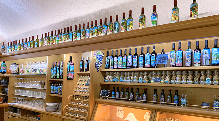 bellagio italy, lake como villages, northern italy towns, la lanterna, bellagio stores, painted wine bottles