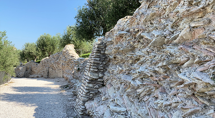 grottoes of catullus, grotte di catullo, defence wall, lake garda, early roman ruins, olive trees, sirmione archaeological site, northern italy, travel to italy,