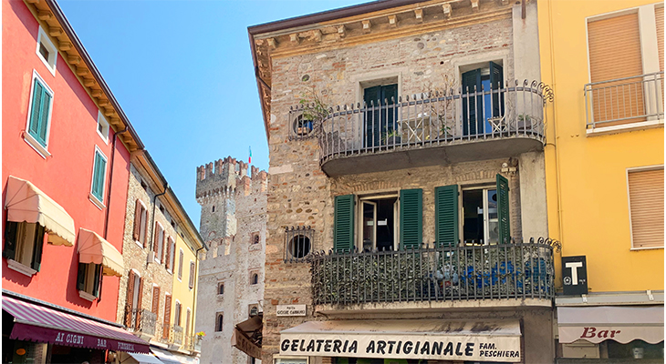 sirmione italy, historic buildings, painted houses, old sirmione, northern italy plants, travel to italy, lombardy, brescia, italian lakes district,