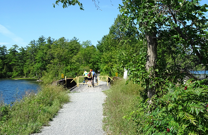 cataraqui trail, bicycle, trail cycling, walk, hike, hiking, tour, eastern ontario, explore, adventure, nature, scenery, wildflowers, gate, cyclists, sydenham, harrowsmith, trees, path, people